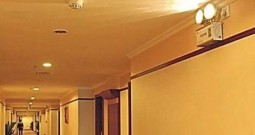 What are emergency lighting fixtures?